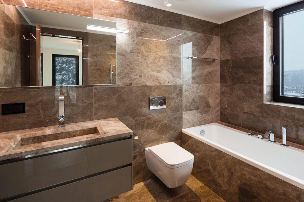 Luxurious marble bathroom with window